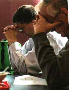 Rob Quiring and retired AAI teacher Chuck Howard praying.