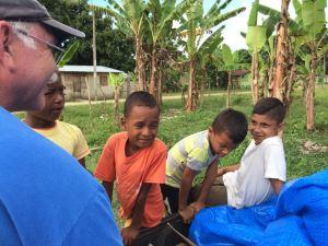 Paramedic Darrell Holden talks with Ecuadorian boys.